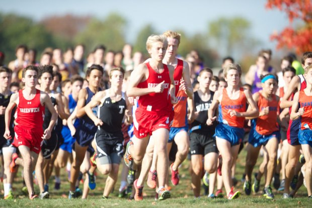 The Greenwich High School boys cross-country team took to the course during the FCIAC championship meet at Waveny Park. In the photo, Greenwich's Andrew Kates, a senior, gets an early jump on the competition. (John Ferris Robben photo)