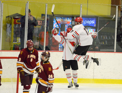 The Greenwich High School boys ice hockey team celebrates a goal during Saturday's FCIAC championship game. (John Ferris Robben photo)