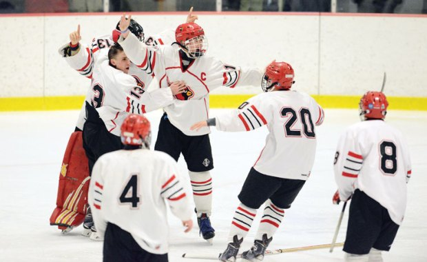 The GHS boys ice hockey team celebrates winning the FCIAC championship game, upending St. Joseph High School 5-0. (John Ferris Robben photo)