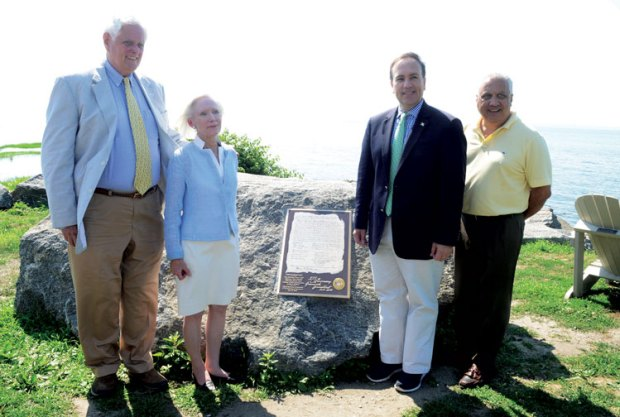 Selectman John Toner, President of the Greenwich Historical Society Davidde Strackbein, First Selectman Peter Tesei and Director of Greenwich Parks and Recreation Joseph Siciliano pose for a photo next to the plaque that commemorates the purchase of the land formerly known as Monakewago from Native Americans. (John Ferris Robben photo)