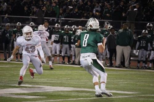 Mike Ceci comes in to pressure Norwalk's quarterback in Friday's 62-34 win. (Evan Triantafilidis Photo)