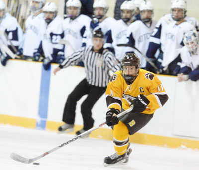 Senior captain Christian LeSueur takes the puck deep in the Hotchkiss zone during Brunswick's home game Monday night. (John Ferris Robben photo)