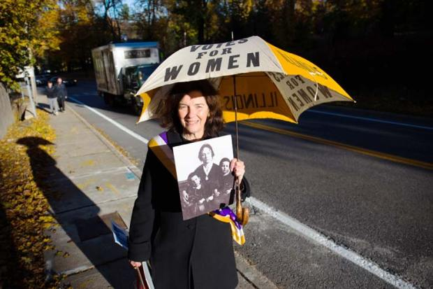 On this past election day, Coline Jenkins sported a 100-year old suffrage movement umbrella and photograph of her great-great grandmother, Elizabeth Cady Stanton, as she went with her son Eric Jenkins-Sahlin to see Hillary Clinton vote in Chappaqua, N.Y. Photo by Eric Jenkins-Sahlin