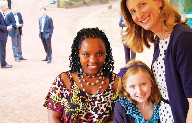 In her support of Partners in Help, Lesley King brought into her family fold Rwandan genocide and cancer survivor Claudine Humure, pictured here with Lesley's daughter, Moira. (contributed photo)