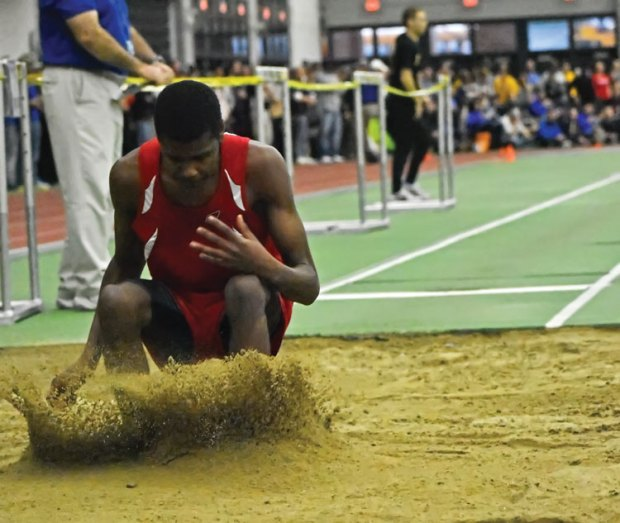 Greenwich High School senior Safir Scott takes second place finish in the long jump during Monday's CIAC state open championship. He bettered himself in the high jump, taking the top spot and gold medal with a height on 11-06. (Paul Silverfarb photo)