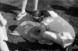 Signing shirts at Girls on the run.
