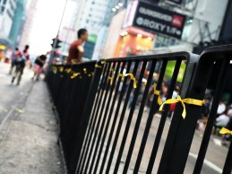 Yellow ribbons symbolizing the movement along the fence in the middle of Nathan Road.