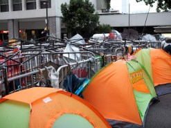People sleeping in tents in front of the blockades to prevent police or anti-occupying supporters from tearing it down.