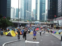Various banners across a pedestrian bridge.