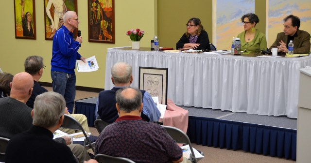 Fr. John Czyzynski, a member of the North American Immigration Committee, addresses panelists at a presentation sponsored by the committee.