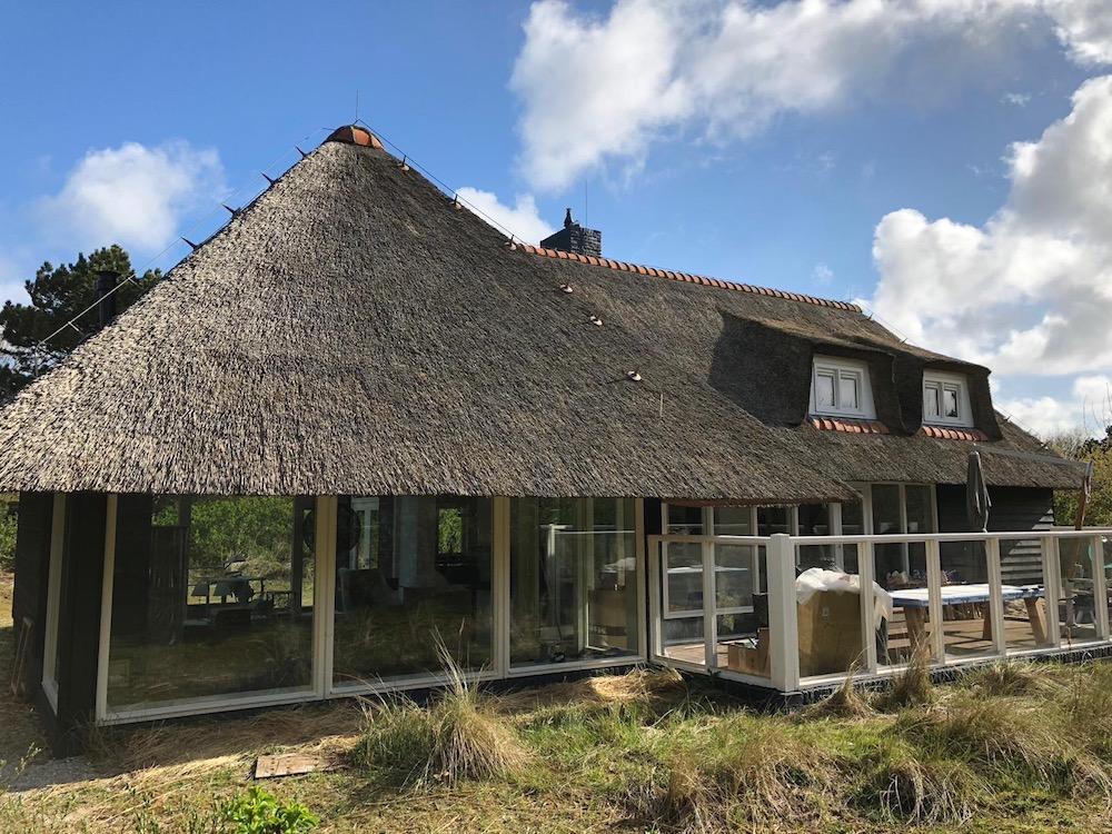 Dubbel gerookte houten vloeren villa Ameland