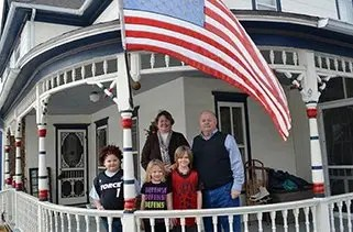Employee Larry Johnson and Family Awarded for Patriotism
