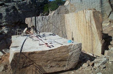 Cut A Block Of Yellow Granite
