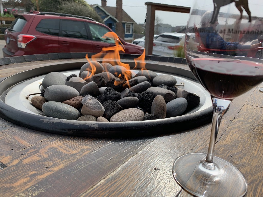 Drinking wine by the fire