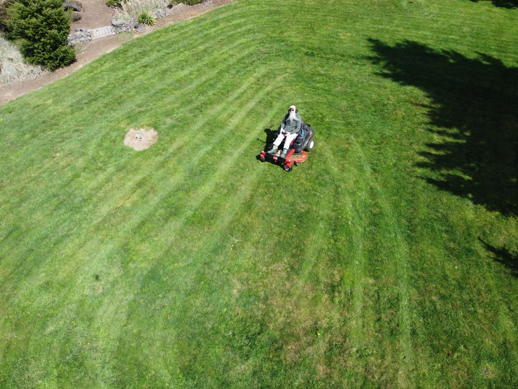 Drone shot of David on mower