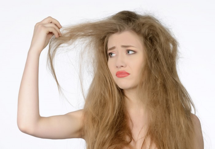 Frizzy-hairdehydrated-hair-image-of-a-model-looking-worringly-at-her-hairs-e1421469875635