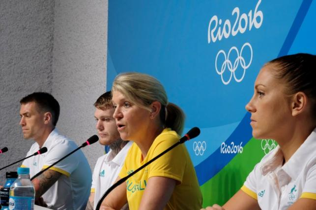 Kitty Chiller (2nd R), Chef de Mission for Australia at the Rio 2016 Olympic Games, leads a news conference with boxers (L-R) James Whateley, Daniel Lewis, and Shelley Watts, in which she described the problems that her country's delegation encountered with the athletes' housing in Rio de Janeiro, July 25, 2016. REUTERS/Rickey Rogers