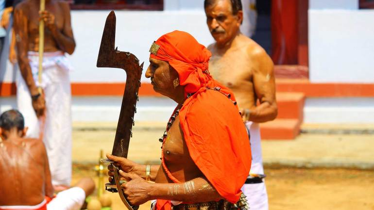 Temple-priest-known-as-Komaram-or-Velichappadu-(Oracle)-performs-just-before-theyyam-performance
