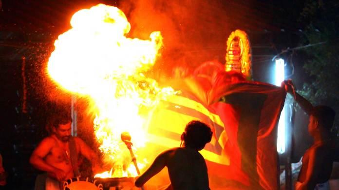 The-fireball-is-flaming-to-show-the-horrible-form-of-demon-Darika-in-Mudiyettu
