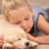 Cute kid sleeping with her puppy