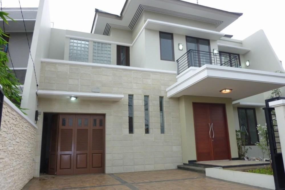 Rumah Batu Alam dengan Dominasi Warna Putih