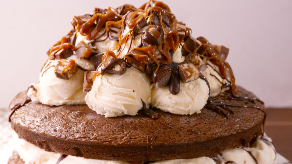 Calling all Snickers lovers: this brownie ice cream cake will blow your mind!Get the recipe from Delish.