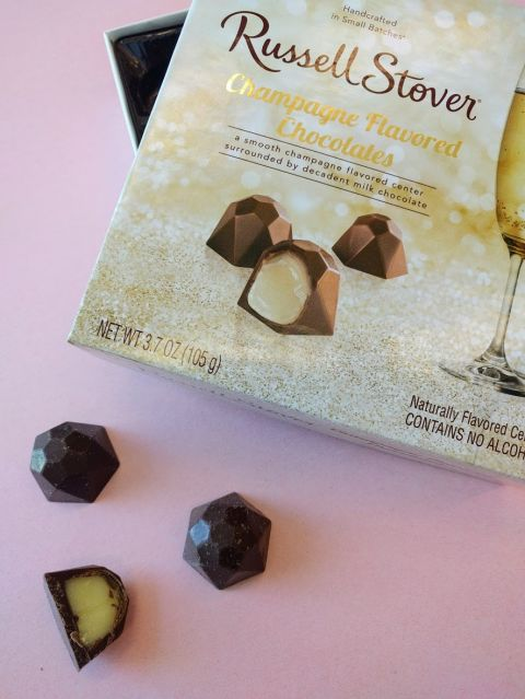 """After the Champagne and rosé gummy trend, it makes sense we'd see even more bubbly-inspired sweets. Russell Stover just launched a 9-piece box of truffles, which have a gooey, champers-flavored center, though they're totally alcohol-free (so no worries if your 6-year-old gets into 'em and declares himself """"chocolate wasted""""). Target, $5"""