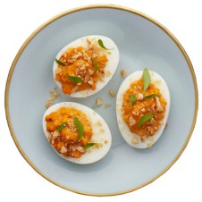 A fresh, spicy take on traditional deviled eggs, this recipe adds hot harissa, sweet almonds, and fresh green herbs for a bit of punch. Recipe: Moroccan Deviled Eggs