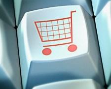 Shopping trolley on button of computer keyboard --- Image by © Matthias Kulka/Corbis