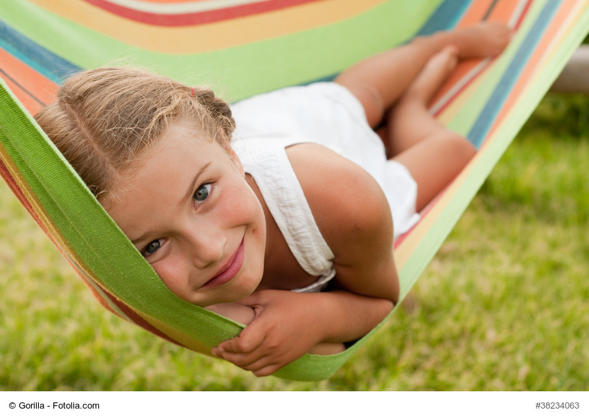 girl resting on hammock.