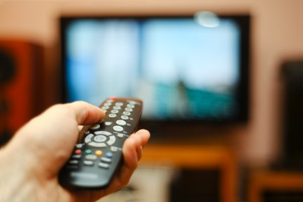 Remote pointed towards a TV representing parental control over media
