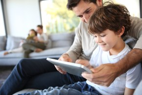 Parent monitoring son's tablet usage