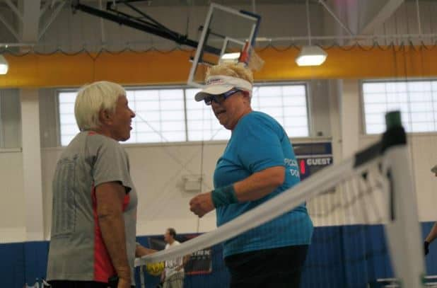 Pickleball: Bonnie Strang, left, and Susan Brooker meet at the net after their hour-and-a-half match. Brooker won 11-4, 8-11 and 12-10 to take home the gold. SUBMITTED PHOTOS
