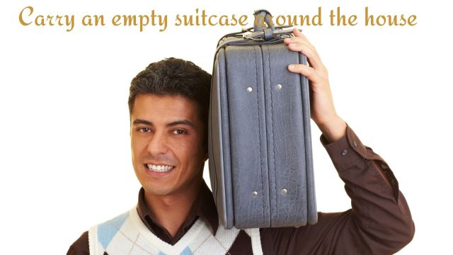 carrying an empty suitcase
