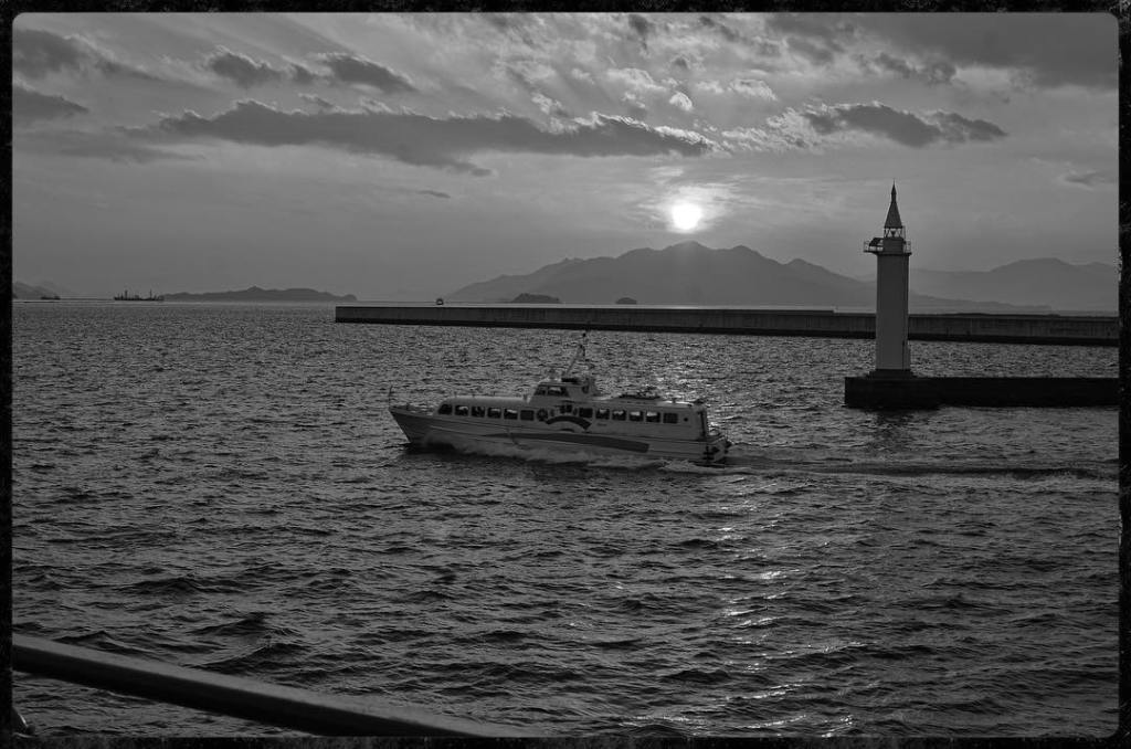 Ferry and lighthouse on the way to Miyajima Island - Nikon D7000 Nikkor AF-S 35mm 1.8G | Del Cook Photography