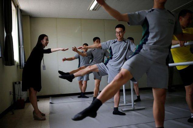 South Korean soldiers perform leg extensions in ballet class | Kim Hong-Ji/Reuters