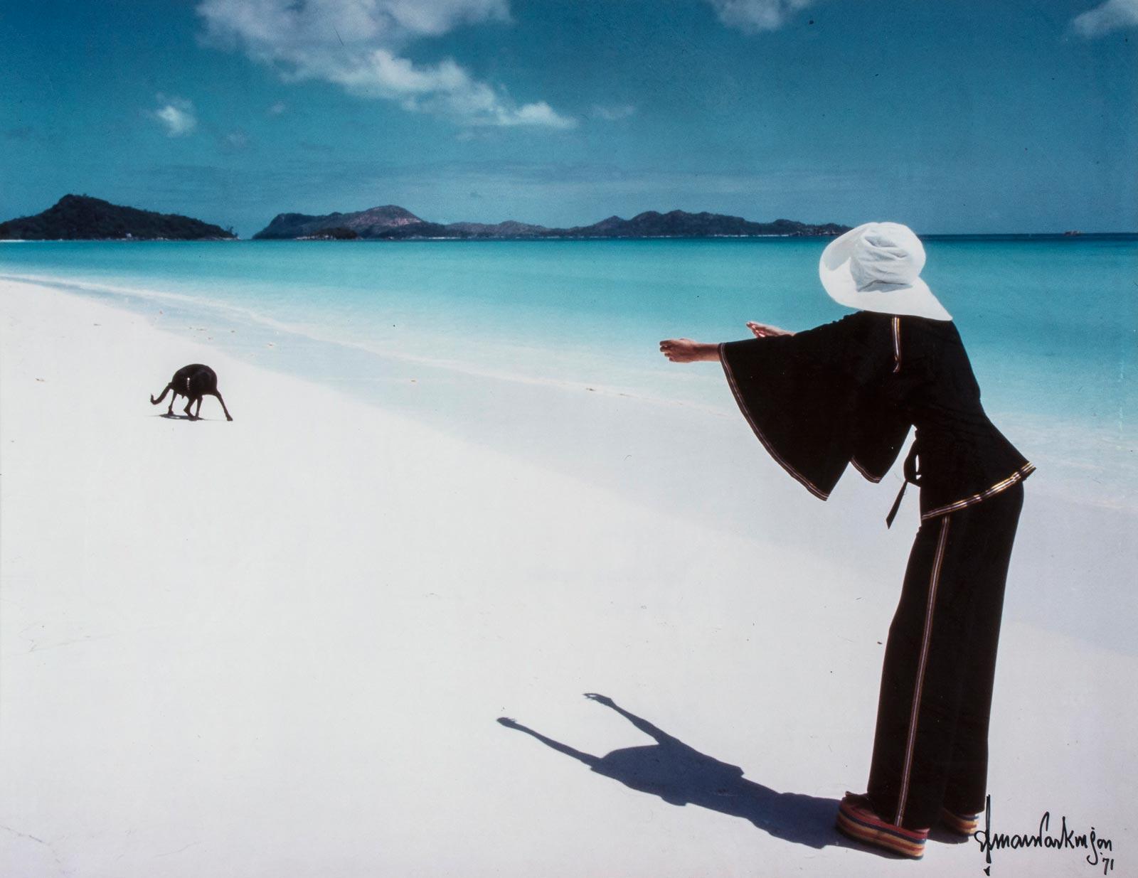 """""""Dog Friday"""", Praslin Island, Seychelles for British Vogue, 1971, Norman Parkinson (1913-1990)."""