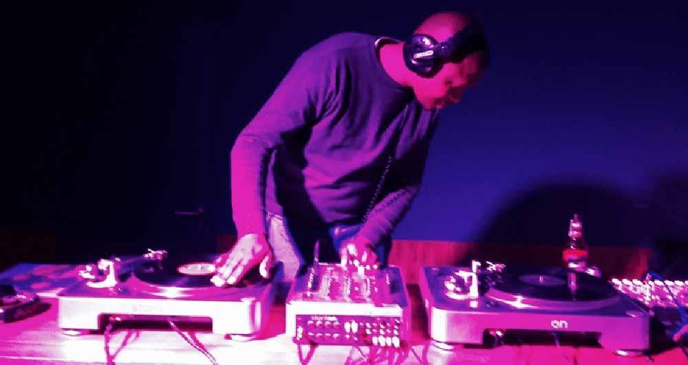 One of Johannesburg's most adventurous DJs Mxolisi Makhubo behind the decks | source: Charles Leonard