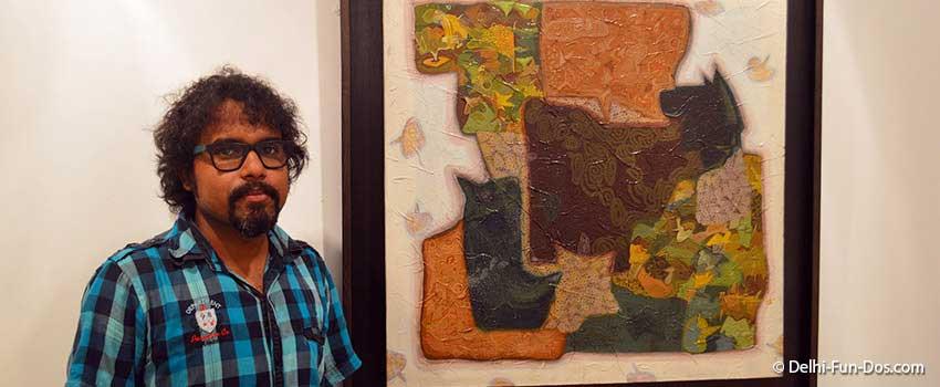 Artist-Pinaki-Ranjan-Bera-with-one-of-his-paintings