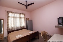 A Semi Deluxe Room, with attached bathroom and satellite TV