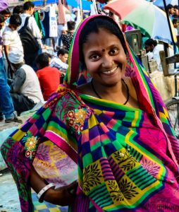 A woman cloth seller in Old Delhi's Sunday market posing for a picture