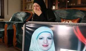 Fatima Baradiya, mother of Aya Baradiya, with a picture of her daughter Photograph: Gali Tibbon