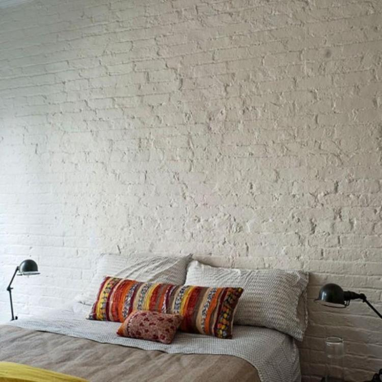 Bold Bedroom with White Brick Walls