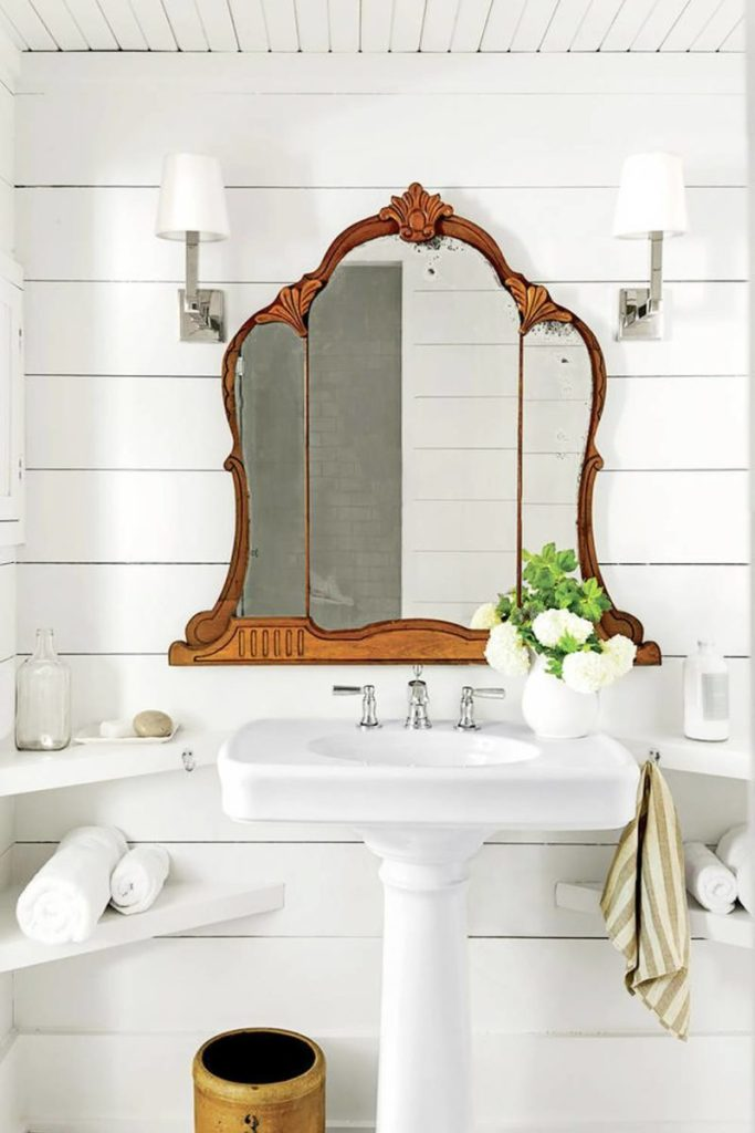 Rustic Mirror on a White Bathroom