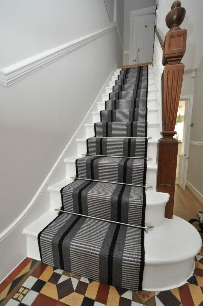Stair carpet with rods