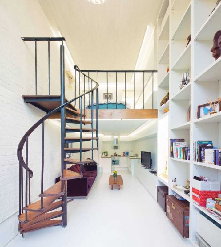 Narrow apartment with spiral staircase and mezzanine