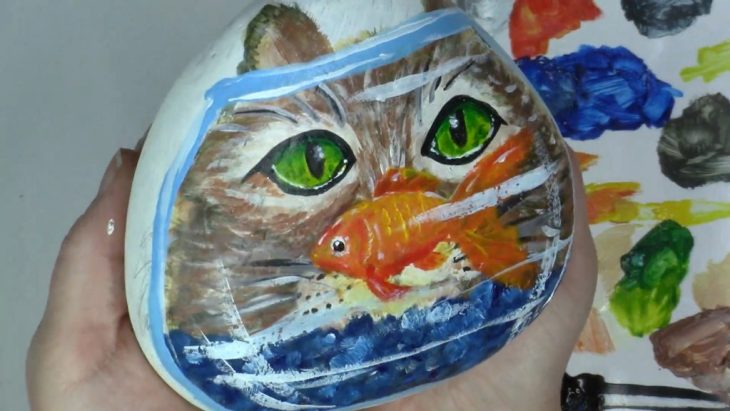 kitten and goldfish in a bowl
