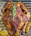 roasted chicken in the oven with herbs
