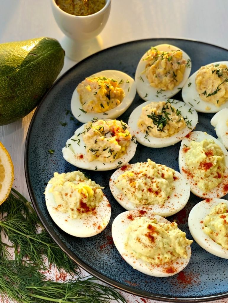Stuffed deviled eggs with avocado and cod liver