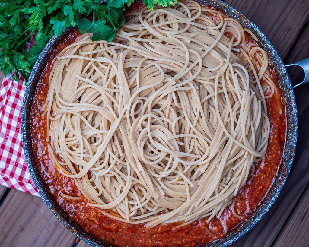 pan with tomato sauce spaghetti